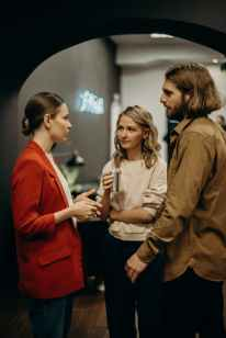 two women and man talking